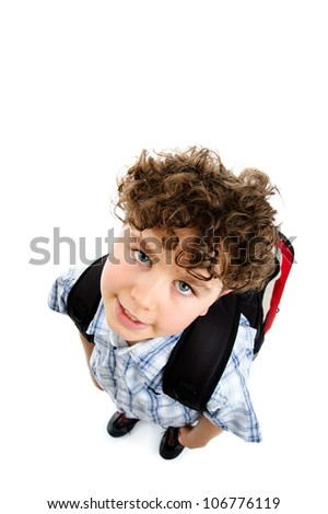 Young boy with backpack on white background - stock photo