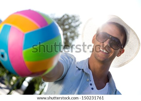 Young boy with ball having fun in a park - stock photo