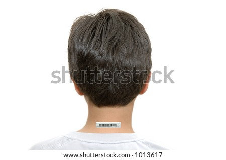 Young boy with bar code tag on the back of his neck - stock photo