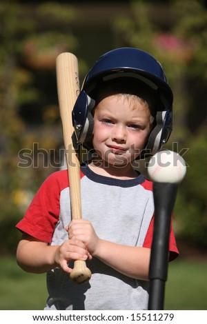 Young boy with baseball equipment - stock photo