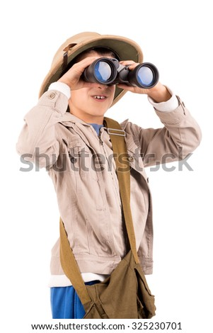 Young boy with binoculars playing Safari isolated in white - stock photo