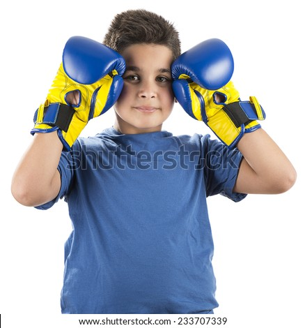 Young boy with blue boxing gloves isolated on white background. - stock photo