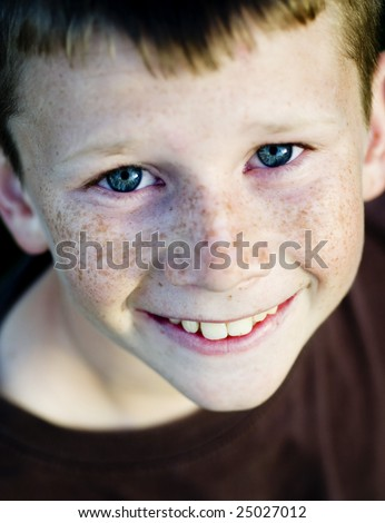 Young boy with blue eyes smiling