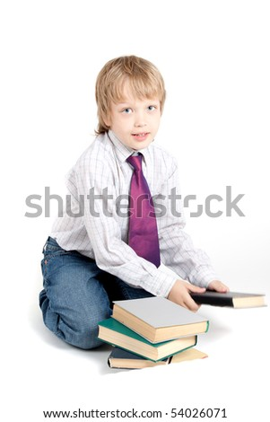 Young boy with books - stock photo