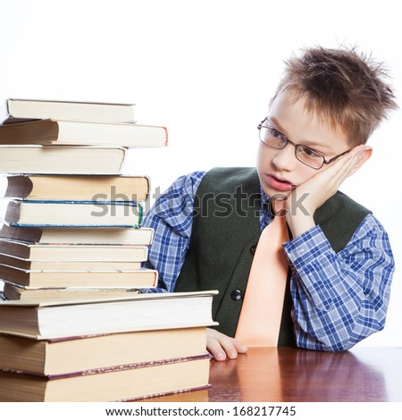 Young boy with books on the white background