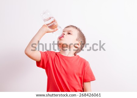 Young boy with bottle mineral water - stock photo
