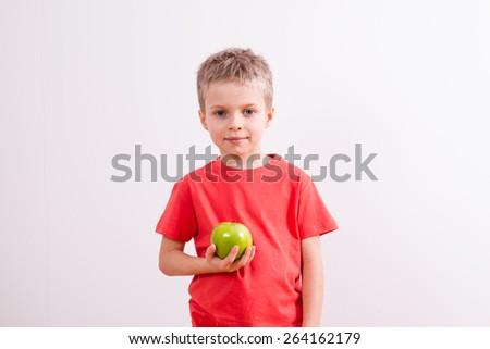 Young boy with bottle orange jouice - stock photo