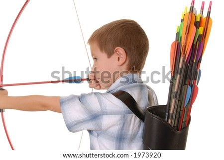 Young boy with bow and arrow practicing archery - stock photo