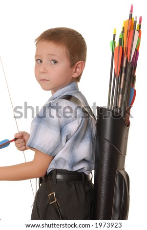 Young boy with bow and arrow practicing archery