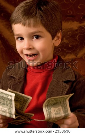 Young boy with cash - stock photo