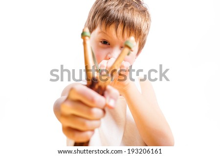 Young boy with catapult