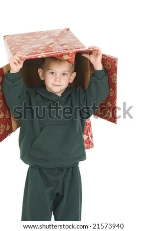 Young boy with Christmas box on his head. Isolated on white. - stock photo