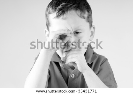 Young boy with cold and headache - stock photo