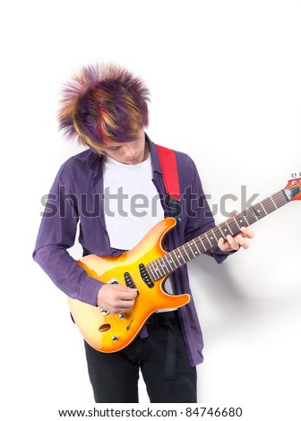 young boy with colored hair with electro gitar - stock photo