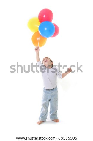 young boy with colorful balloons over white