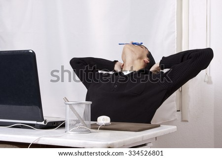 young boy with computer asleep
