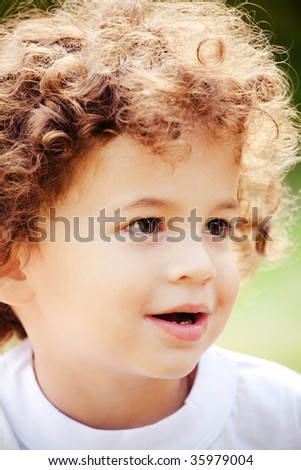 Young boy with curly hair portrait