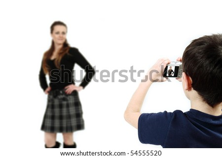 Young boy with digital camera prepare for shooting mother - stock photo