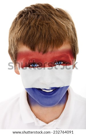 Young boy with Dutch flag painted on his face - stock photo