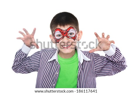 Young boy with face painting on spider man - stock photo