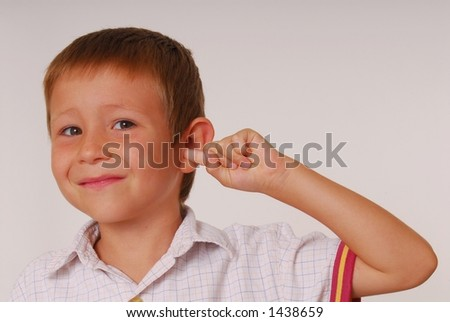Young boy with finger in ear