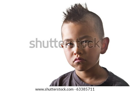 Young boy with funny mohawk haircut and serious look isolated on white background