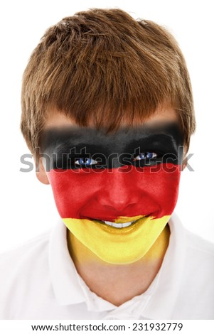 Young boy with Germany flag painted on his face - stock photo