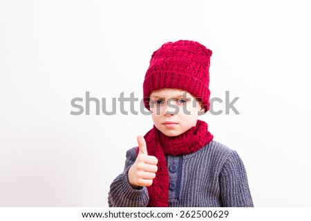 Young boy with gestures - stock photo