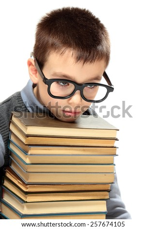 Young boy with glasses and books  isolated on white background - stock photo