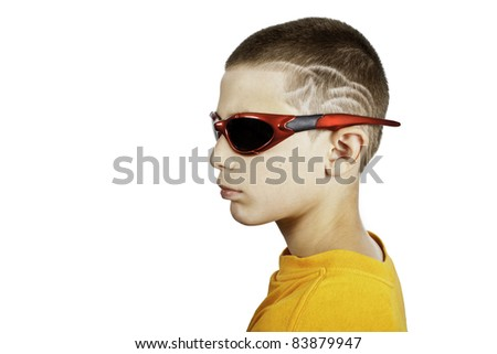 young boy with glasses and special hair cut