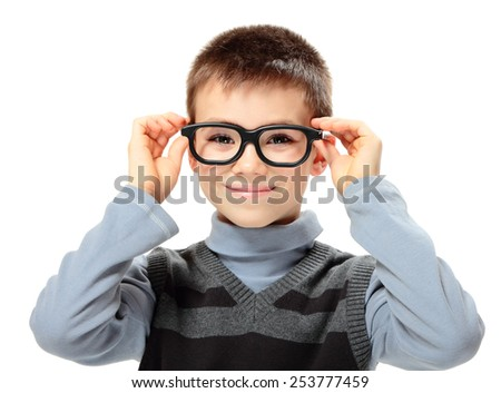 Young boy with glasses isolated on white background - stock photo