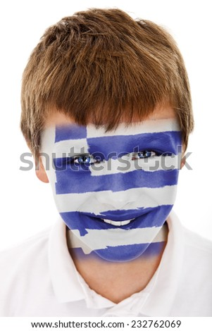 Young boy with Greek flag painted on his face - stock photo