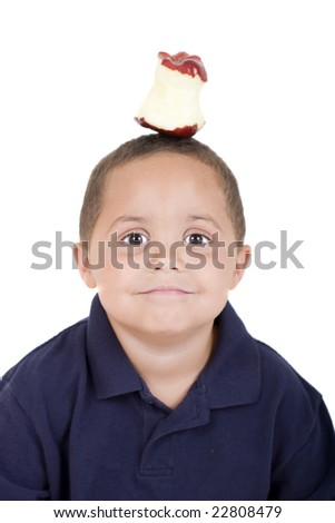Young boy with half eaten apple on his head - stock photo