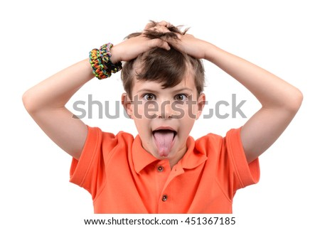 young boy with hands in hair and tongue sticking out isolated white background - stock photo