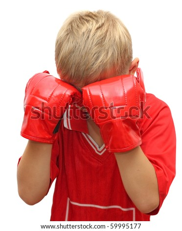 Young boy with hands in red gloves on his face. - stock photo