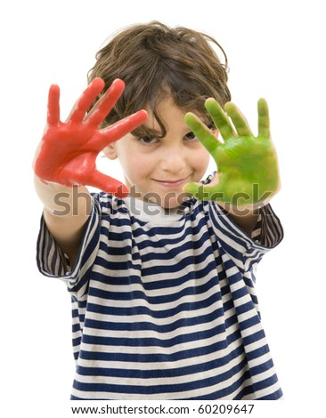 young boy with hands painted in red and green - stock photo