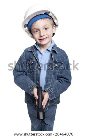 young boy with hard hat and flashlight - stock photo