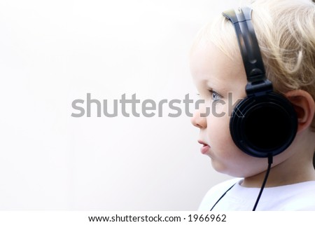 young boy with headphones - stock photo