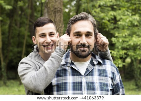 Young boy with his father at countryside - stock photo