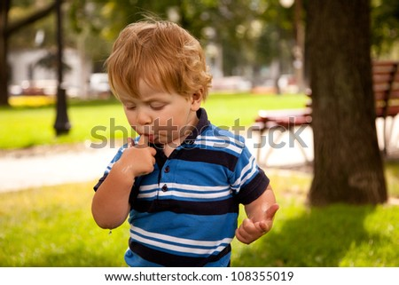 young boy with his finger in his mouth