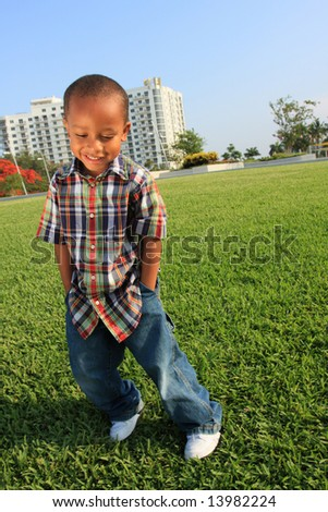 Young Boy with his Hands in his Pockets - stock photo