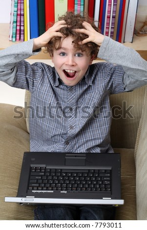 Young boy with his laptop  resting at home