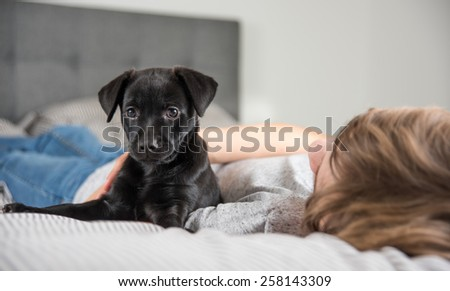 Young Boy with His New Puppy