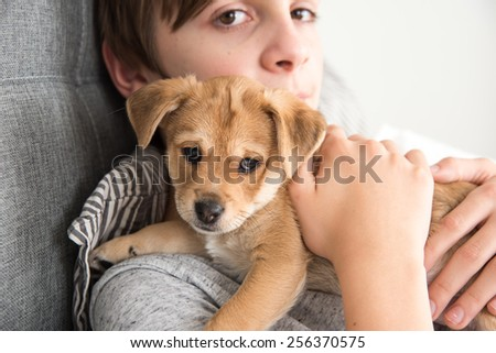 Young Boy with his New Puppy Brother