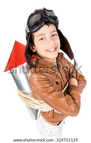 Young boy with home made rocket ready for adventure  - stock photo