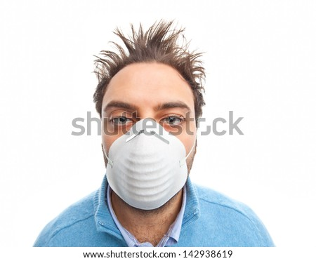 Young boy with masl respiratory protection on white background - stock photo