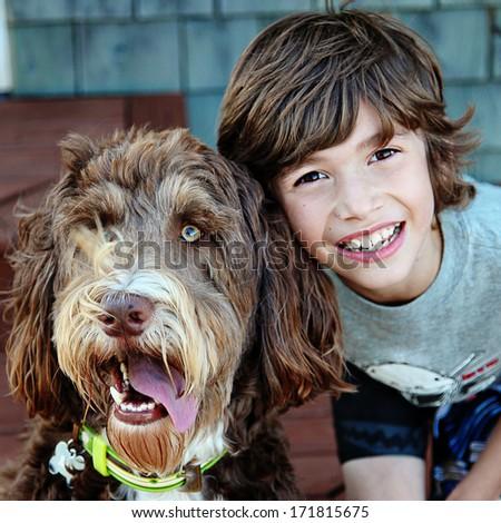 Young boy with Pet Dog closeup - stock photo