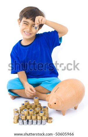 Young boy with pigbank and golden - silver coins . - stock photo