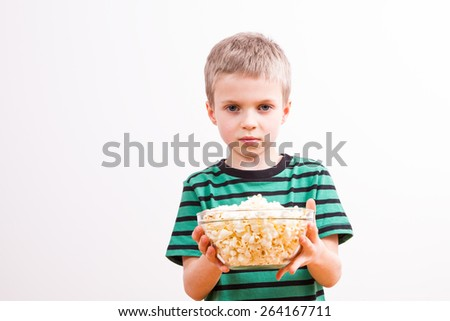 Young boy with popcorn - stock photo