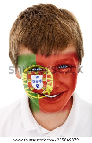 Young boy with portugal flag painted on his face - stock photo
